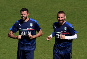 FLORENCE, ITALY - MAY 24:  Andrea Barzagli (L) and Daniele De Rossi smile during the Italy training session at the club's training ground at Coverciano on May 24, 2016 in Florence, Italy.  (Photo by Claudio Villa/Getty Images)