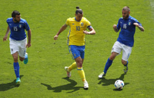 Sweden's Zlatan Ibrahimovic is chased by Italy's Andrea Barzagli, left, and Daniele De Rossi during the Euro 2016 Group E soccer match between Italy and Sweden at the Stadium municipal in Toulouse, France, Friday, June 17, 2016. (AP Photo/Hassan Ammar)